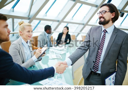 Handshake after introduction - stock photo