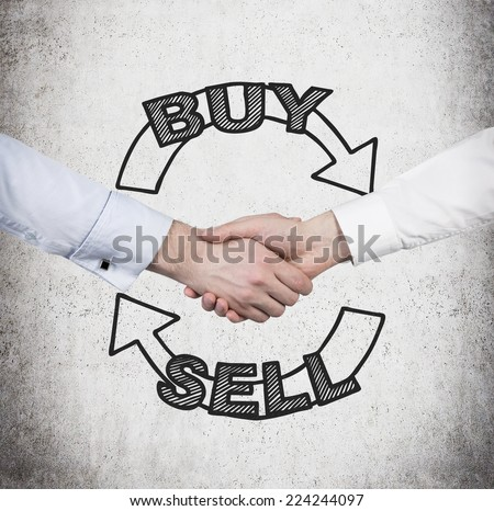 Handshake and a choice to 'sell or buy'. A concept of trading.  - stock photo