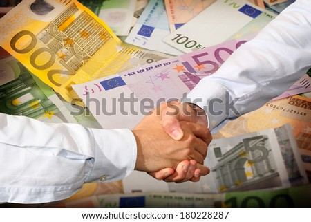 Handshake and Euro Banknotes Background - stock photo