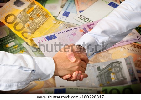 Handshake and Euro Banknotes Background - stock photo