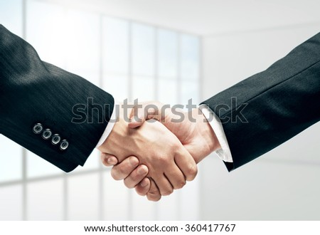 handshake and office on background - stock photo