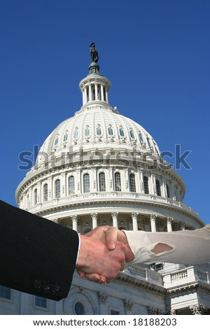 handshake between business people and US Capitol building - stock photo