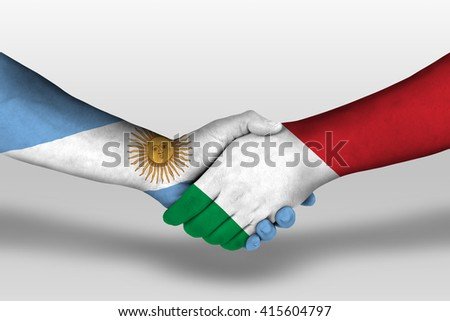 Handshake between italy and argentina flags painted on hands, illustration with clipping path. - stock photo