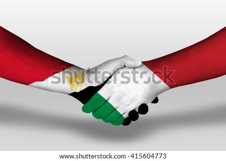 Handshake between italy and egypt flags painted on hands, illustration with clipping path. - stock photo