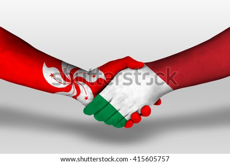Handshake between italy and hong kong flags painted on hands, illustration with clipping path. - stock photo