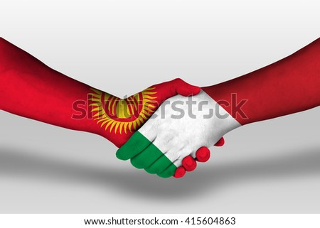 Handshake between italy and kyrgyzstan flags painted on hands, illustration with clipping path. - stock photo