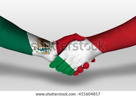 Handshake between italy and mexico flags painted on hands, illustration with clipping path. - stock photo