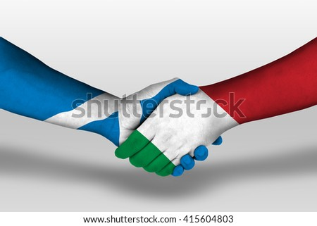 Handshake between italy and scotland flags painted on hands, illustration with clipping path. - stock photo
