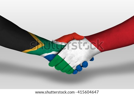 Handshake between italy and south africa flags painted on hands, illustration with clipping path. - stock photo