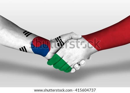 Handshake between italy and south korea flags painted on hands, illustration with clipping path. - stock photo
