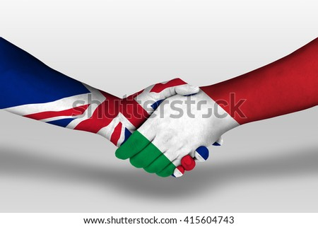 Handshake between italy and united kingdom flags painted on hands, illustration with clipping path. - stock photo