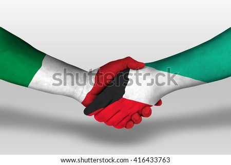 Handshake between kuwait and italy flags painted on hands, illustration with clipping path. - stock photo