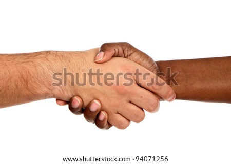 Handshake between races a over white background - stock photo