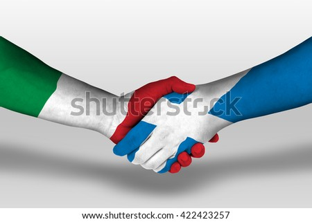 Handshake between scotland and italy flags painted on hands, illustration with clipping path. - stock photo