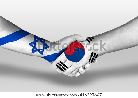 Handshake between south korea and israel flags painted on hands, illustration with clipping path. - stock photo