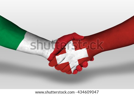 Handshake between Switzerland and Italy flags painted on hands, illustration with clipping path. - stock photo
