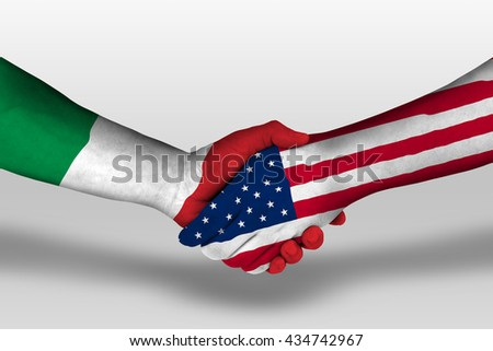 Handshake between united states of america and italy flags painted on hands, illustration with clipping path. - stock photo