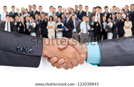 handshake businessmen, over big group of businesspeople background, hand shake concept of global international business collaboration, human resources, communication - stock photo