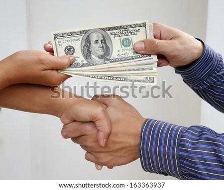 Handshake exchange - stock photo