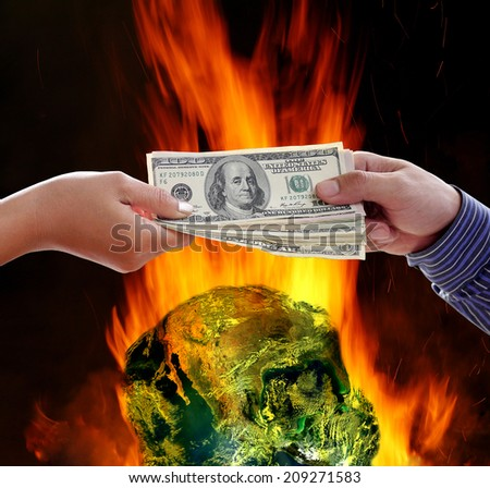 Handshake exchange on burning globe earth background. Element of this image furnished by NASA - stock photo