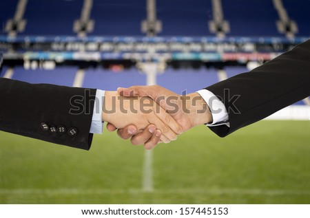 handshake in a business in the sport of soccer - stock photo