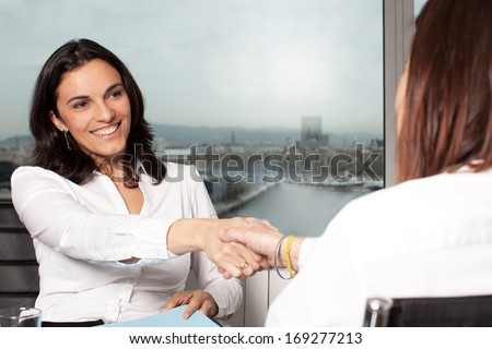 Handshake in board room - stock photo