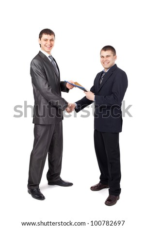 Handshake of business partners, when signing documents isolated on white background - stock photo