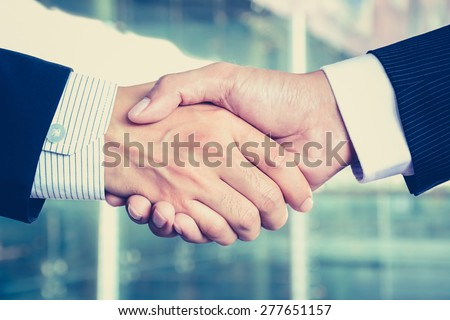 Handshake of businessmen, vintage tone - congratulation, greeting & business partner concepts - stock photo