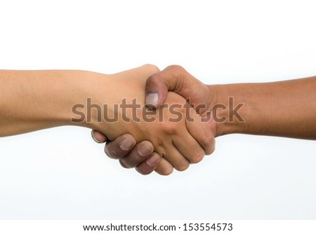 Handshake of friendship isolated on white background - stock photo