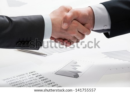 Handshake of successful business partners after meeting - stock photo