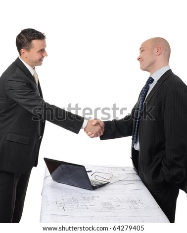 Handshake of two business partners after signing a contract. - stock photo