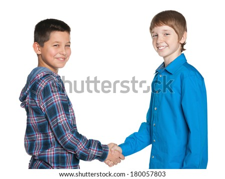 Handshake of two cheerful boys on the white background - stock photo