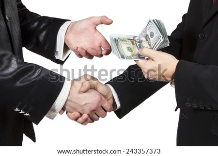 Handshake of two men with the transfer of money from one another isolated on white background - stock photo