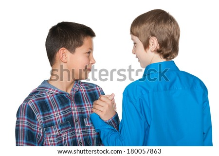 Handshake of two preteen boys on the white background - stock photo