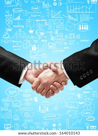 handshake on a business concept background - stock photo