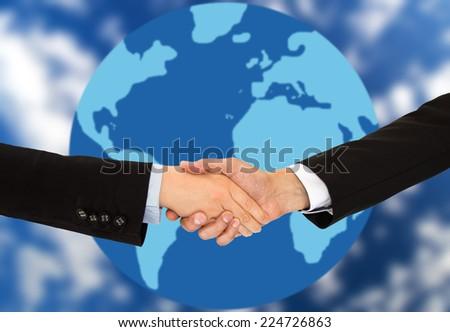 handshake on a global business - stock photo