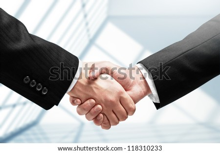handshake on a room background - stock photo