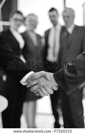 Handshake on business background - stock photo