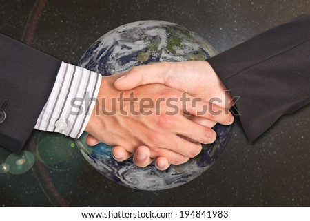 handshake on the background of the planet earth. Elements of this image are furnished by NASA - stock photo