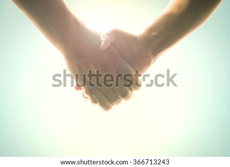 Handshake symbol forming a heart over blue sky background. World Cancer Day We I Can Trust Love Health Care Two Happy Idea Business CSR Solidarity Unity Synergy Autism Awareness Labor Labour concept. - stock photo