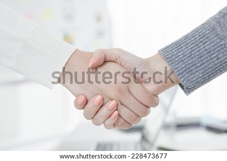 Handshake to a business woman - stock photo