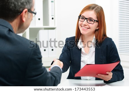 Handshake to seal a deal after a job recruitment meeting - stock photo