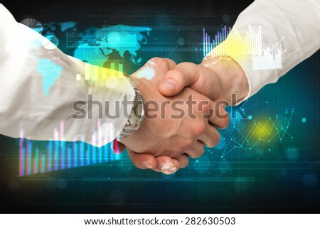 Handshake with charts and diagrams background - stock photo