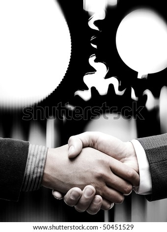 handshake with gears background - stock photo