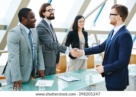 Handshake with new partner - stock photo