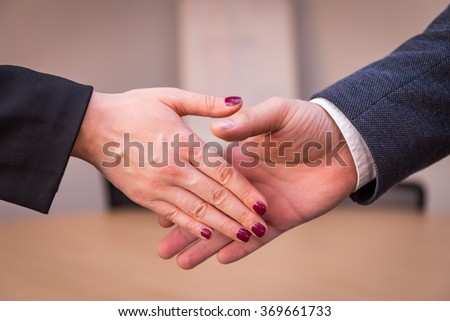 Handshaking in office - stock photo