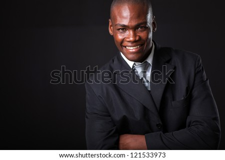 handsome african american businessman on black background - stock photo