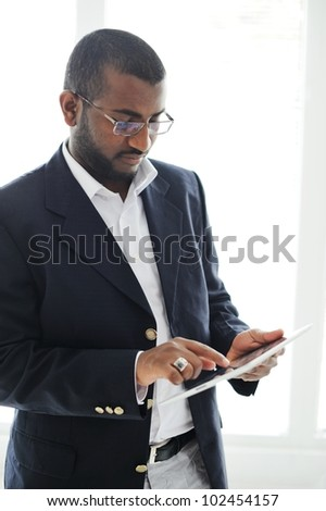 Handsome African American man with tablet computer - stock photo