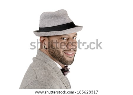 Handsome African American young man in hat looking at camera. Copy space - stock photo
