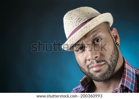 Handsome African American young man in hat looking at camera. Copy space. - stock photo